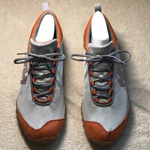 Merrill sneakers in gray with orange accents.